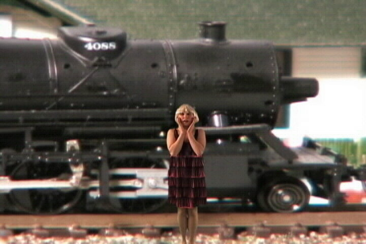Cheryl in front of steam engine,train video,train video clip,railroad video,model railroad video,model train video,steam train video,free train video,steam trains video clip,model train dvd,model railroad dvd