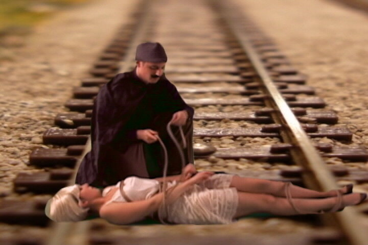 Cheryl tied to railroad tracks,train video,train video clip,railroad video,model railroad video,model train video,steam train video,free train video,steam trains video clip,model train dvd,model railroad dvd
